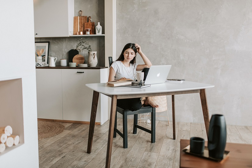 focused-young-woman-with-laptop-and-books-at-home-4050326.jpg