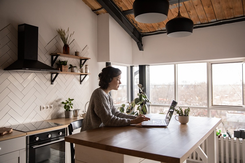 young-woman-surfing-laptop-in-kitchen-4049990.jpg